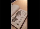 image of an anatomy book open to a page with a drawing of a human skeleton