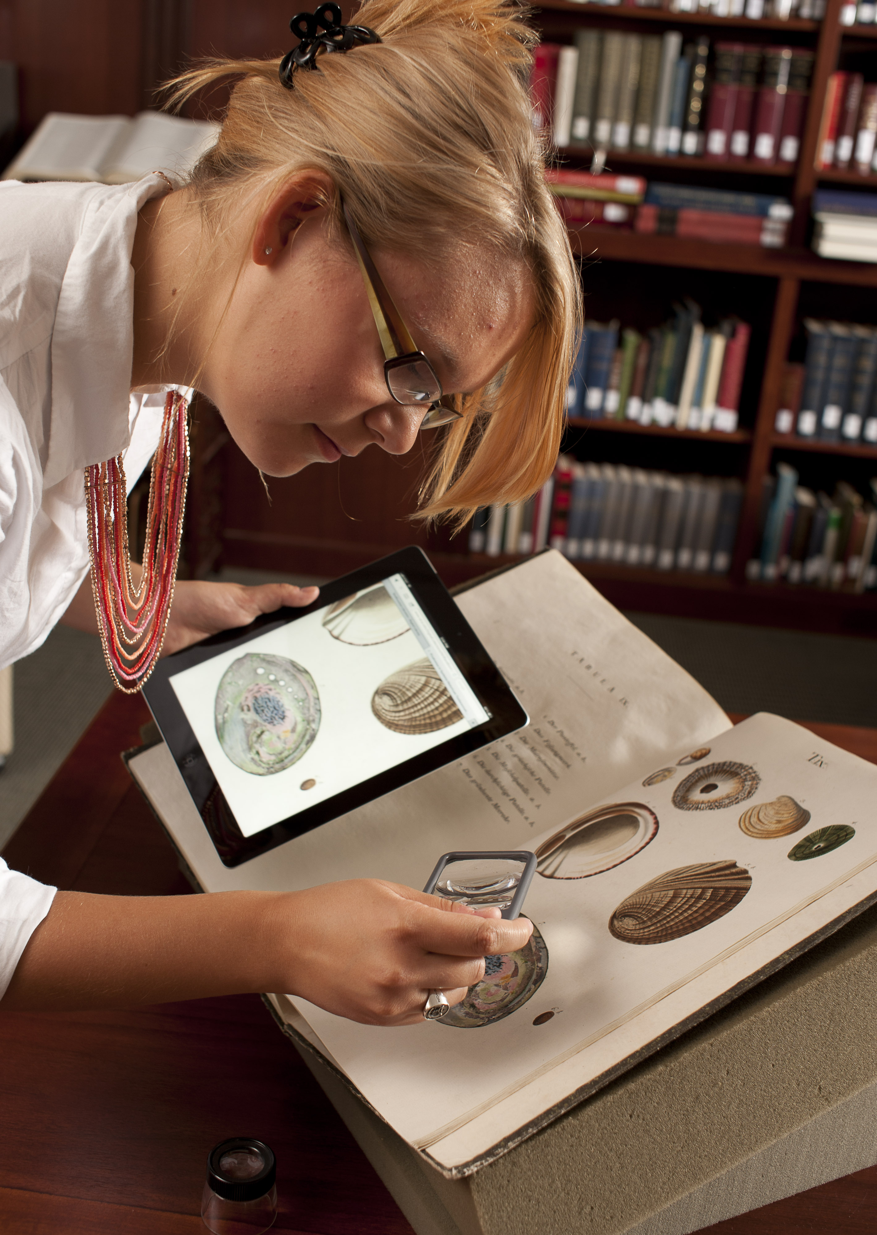 Intern with ipad and natural history book