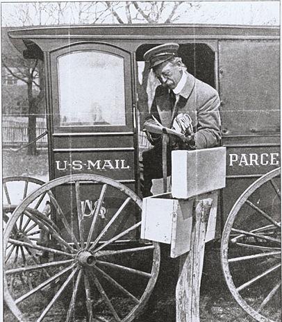 B/W photo of post man half sitting in US Mail cart