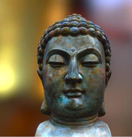 A small bronze sculpture of Buddha.