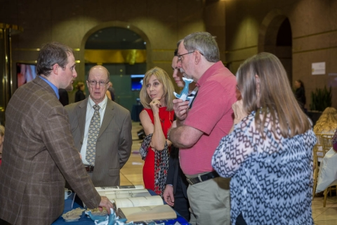 Guests learn about whales at an exclusive event in Phoenix, AZ.