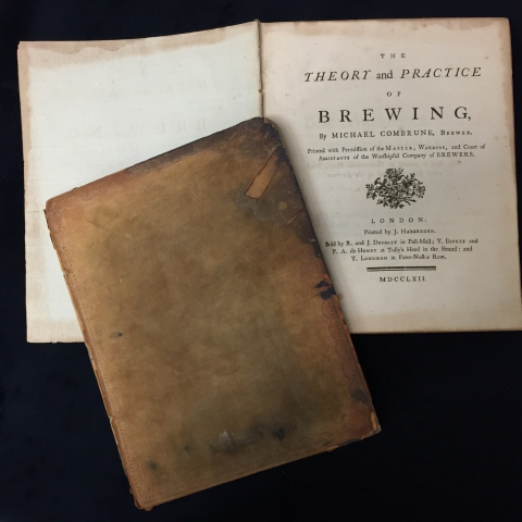 The separated front cover and the title page of Combrune's 1762 book on brewing