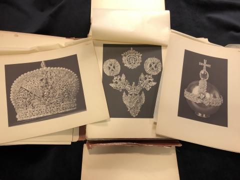 Three plates of crown jewels