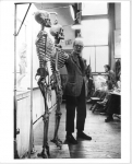 R. B. Hale teaching class with skeletons