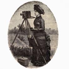 photo of a woman using a glass plate negative camera.
