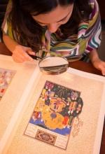 Researcher studying Arabic manuscript
