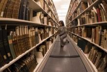 Lilla Vekerdy shelving books