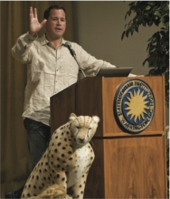 Image of Jeff Corwin speaking at a podium at the Smithsonian.