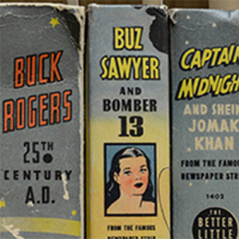 spines of bound comic books including Buck Rogers and Captain Midnight
