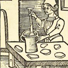 Crude print showing a man at a table pounding something in a large mortar and pestle. From Ortus sanitatis.
