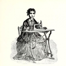 19th century woman sitting at a sewing machine