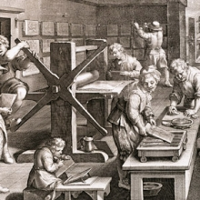 engraving showing interior of 17thc. printing shop with roller press and drying prints