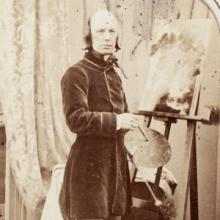 Carte de visite portrait of painter George Lance standing in front of a canvas.