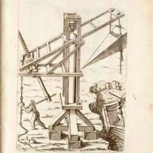 woodcut print of an early crane lifting a pyramidal block.