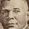 Crop of a zoom-in of a 10-cent postage stamp honoring Booker T Washington