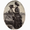 photo of a woman using a glass plate negative camera.