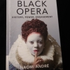 The cover of the book Black Opera with a black woman wearing an elizabethan ruff collar, curly red hair and white face paint.