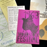 Pamphlets, a schedule, and flyer for the Woodstock Festival in 1963