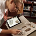 iPad and Rare book being used together