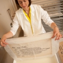 Book conservationist restoring a book in a washing tray