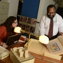 Researchers in the library with books and manuscripts