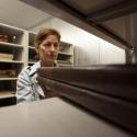 Rare book librarian shelving large books