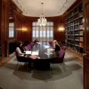 Image of the North Reading Room with a large table in the middle surrounded by built-in shelves of books and an ornate ceiling