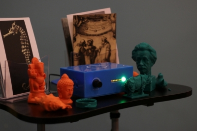 assortment of 3D objects and postcards associated with Museum in a Box